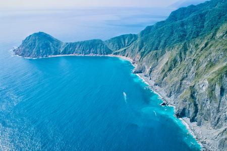 Wushihbi Aerial View - Blue seawater with morning bright sunlight, birds eye view use the drone, shot in Suao Township, Yi LAN, Taiwan. Stok Fotoğraf