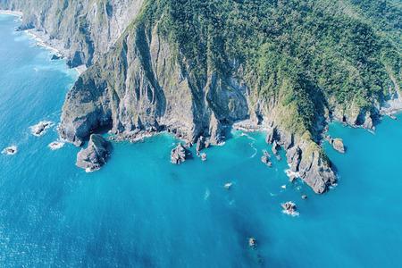 Fenniaolin Aerial View - Blue seawater with morning bright sunlight, birds eye view use the drone, shot in Suao Township, Yilan, Taiwan. Stok Fotoğraf