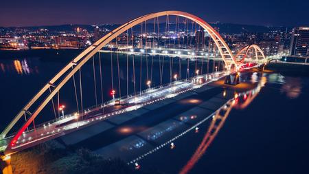 Crescent Bridge - Famous landmark of New Taipei, Taiwan with beautiful illumination at night, aerial photography in New Taipei, Taiwan.