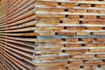 stored: Stack of wooden boards stored outdoors
