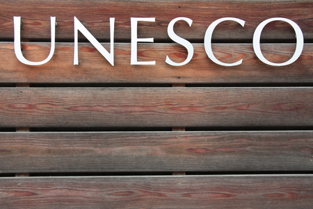 UNESCO text on brown wood background