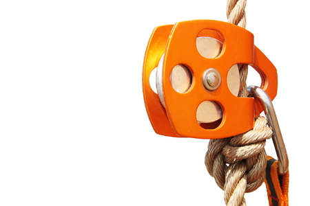 Orange Climbing Pulley with rope and carabiner (isolated)