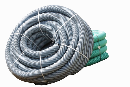 Corrugated plastic pipes used for underground electrical lines (isolated) Stock Photo