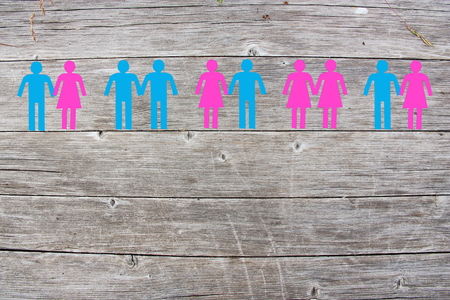 Gay lesbian and straight couples on wooden background Archivio Fotografico