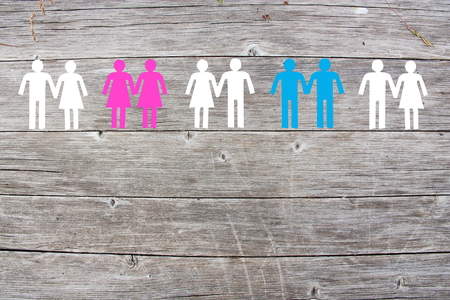 Gay lesbian and straight couples on wooden background Foto de archivo