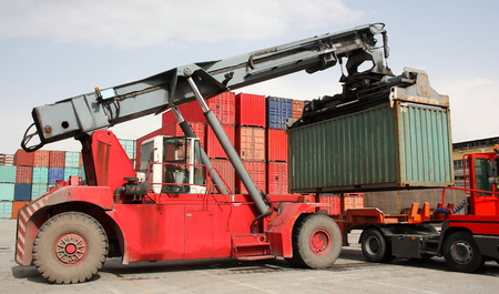 Reach stacker vehicle moving to container into a container terminal area