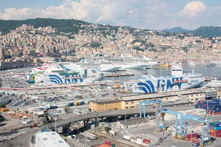 ITALY, GENOA - June 16, 2018: Ferry boats and cruise ships docked in the port of Genoa Italy. 新聞圖片