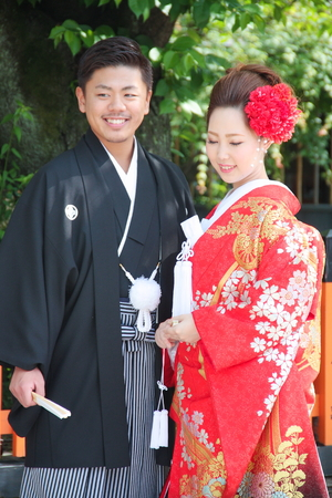 JAPAN, KYOTO - MAY 17, 2016: Beautiful bride and groom wearing traditional japanese wedding dress in Kyoto Japan.