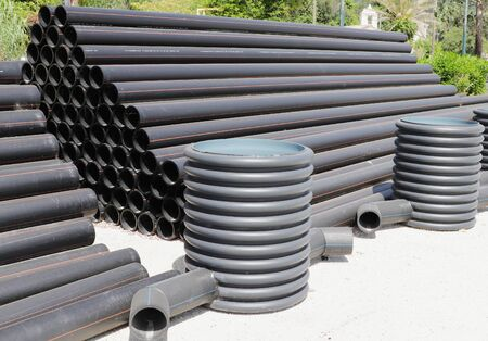 Stack of black plastic pipes