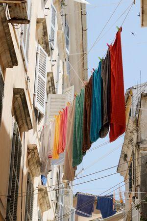 Hanging laundry on a narrow street in Corfu Greece 写真素材