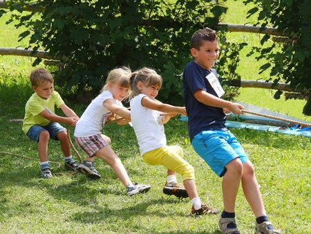 ITALY, San Vigilio Marebbe - JULY 23 2014: Children playing tug of war during summer games at S. Vigilio Marebbe (Italy) 報道画像