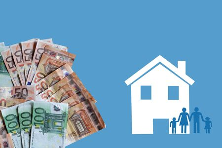 White home and family with euro banknotes on blue background