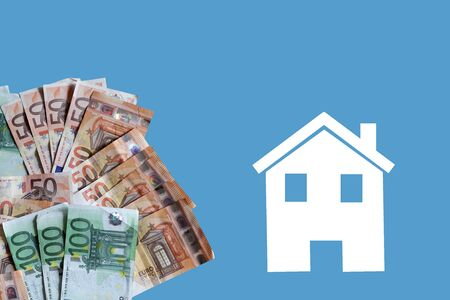 White home with euro banknotes on blue background