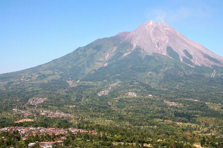 Merapi the most active volcano in Indonesia and the crowded villages on its flanks Yogyakarta Java Indonesia