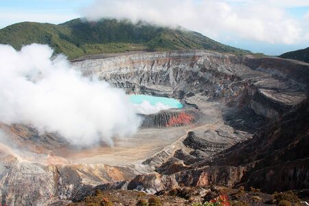 Poas Volcano Crater with its acid lake and fumarole Costa Rica