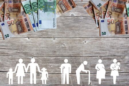 Family and Weak social categories welfare concept with euro banknotes on wooden background