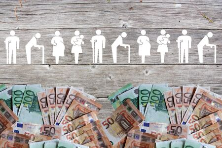 Weak social categories welfare concept with euro banknotes on wooden background