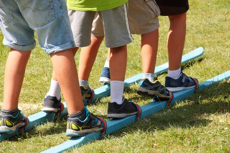 Children using a pair of skis during summer games