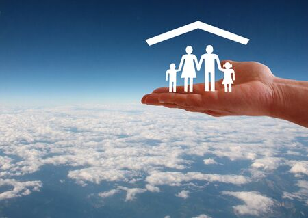 Family welfare concept with hand on roof sky aerial background
