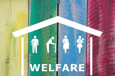 Weak social categories welfare concept with house and rooftop on wooden colored background