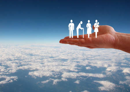 Weak social categories welfare concept with hand on aerial sky view background