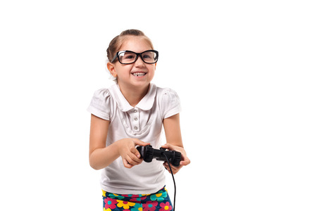 Young little girl play videogame by gamepad on the white isolated background