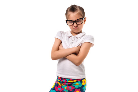 little girl in glasses standing in the pose of business Banco de Imagens