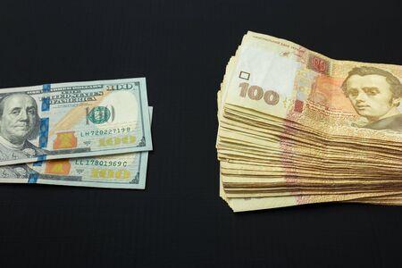 Value of Ukrainian hryvnia and American dollars. Hryvnia lie next to dollars 写真素材 - 142147701