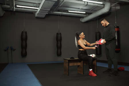 A disabled girl is engaged in the gym. a woman with one leg trains with a trainer in boxing, she learns to fight