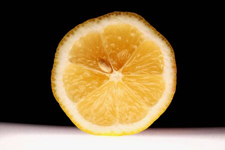 Lemon slice on black background Stock Photo - 6443472