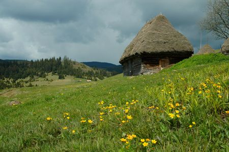 Old farmers wooden house in Transylvania, Romania photo