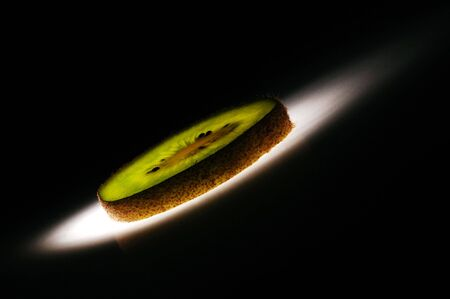 Kiwi fruit slice on black background Stock Photo - 7901531