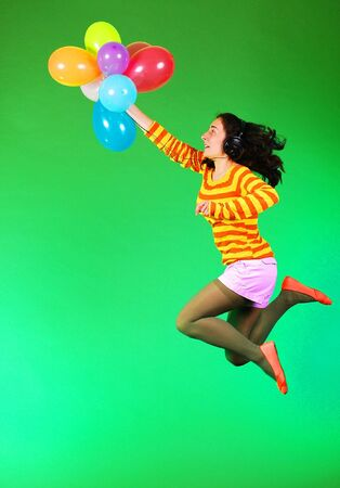 Jumping happy girl with balloons Stock Photo - 7981261