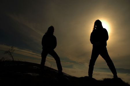 aura sun: Silhouette of rockers in the darkness, sun aura in background Stock Photo