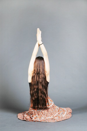 Hippie girl doing yoga exercise photo