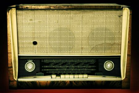 Old radio isolated on a dark background  photo