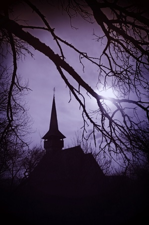 Draculas land at sunset, church in Transylvania