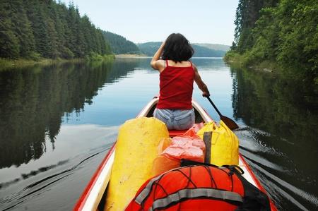 Canoeing girl on a lake