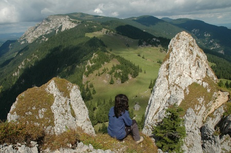 Girl on the top of the mountain. View from Piatra Singuratica (Egyesko) Hasmasu Mare mountains, Romania photo