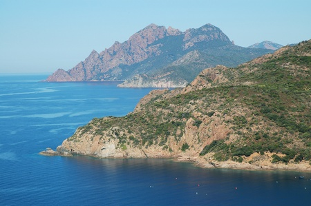 Rocky coastline in Corsica, France  photo