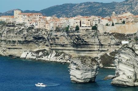 Bonifacio old town on sea cliff, Corsica, France photo