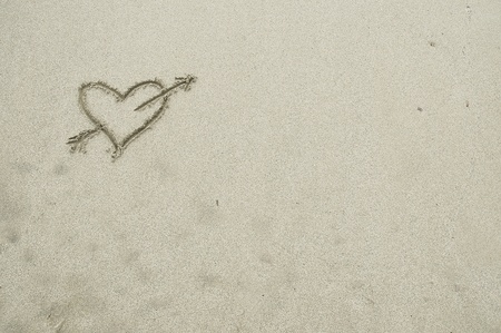 A heart drawn in sand - space for text photo