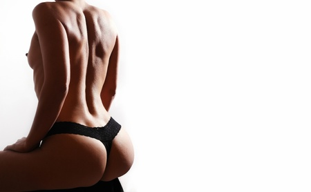 Beautiful ass of young woman over white background  - space for text Stock Photo - 11909702