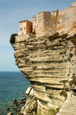 Bonifacio old town on sea cliff, Corsica, France photo