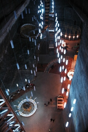 TURDA - CCA. MARCH: Tourists visiting the Salt Mine, after the opening of the new re-designed interior. The costs of rehabilitation were covered by EUR 6 million PHARE funding. 2010, in Turda, Romania Stock Photo - 11887111