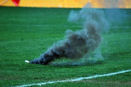 CLUJ-NAPOCA, ROMANIA - APRIL 14: A smoke bomb spews smoke at the Romanian National Championship soccer game, CFR Cluj vs. Universitatea Cluj, April 14, 2011 in Cluj-Napoca, Romania  photo