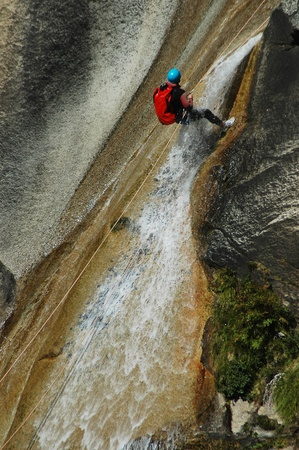 PURCARACCIA CANYON, CORSICA - AUGUST 28: An extreme sports team participates in a canyoning contest on the famous waterfalls of Purcaraccia valley, on August 28, 2010 in Corsica, France