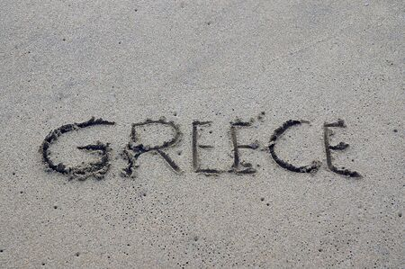 Greece, letters on the sand Stock Photo - 11957617
