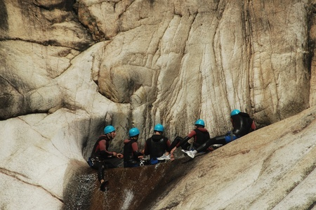 PURCARACCIA CANYON, CORSICA � AUGUST 28: An extreme sports team participates  in a canyoning contest on the famous waterfalls of Purcaraccia valley, on August 28, 2010 in Corsica, France