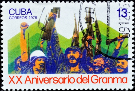 CUBA - CIRCA 1976: A Stamp shows the image of Fidel Castro and Che Guevara after they landing in Cuba during the Cuban Revolution, printed for the XX Anniversary of Granma, in Cuba, circa 1976  photo